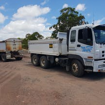Logo of Mick Grech Tipper and Water Truck Hire