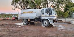 Ballard's Earthmoving & Demolition Truck Mounted Water Cart