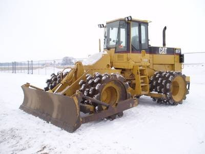 CAT 815 or Equivalent Compactor for hire - Hunter Bros Earth Movers Pty Ltd