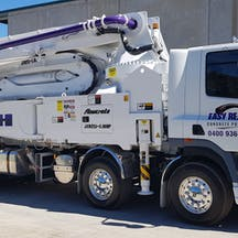 Logo of Easy Reach Concrete Pumping